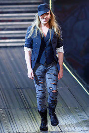 John Galliano paired his ripped jeans with cool lace-up boots and a military cap.