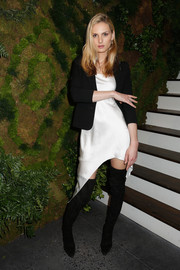 Andreja Pejic layered a black blazer over an asymmetrical-hem LWD for the John Hardy Artisan in Residence launch.