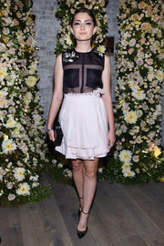 Emily Robinson continued the cutesy vibe with a ruffled mini skirt, also by ADEAM.