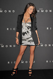 This longer length blazer with rolled up sleeves was a great choice for the menswear event she attended in Milan.