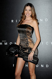 Aida Yespica paired a beaded black clutch with her sexy strapless dress at the John Richmond fashion show.