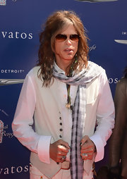 Steven Tyler added some pattern to his all white look with this black and white checkered scarf.