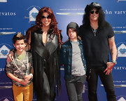 Slash kept it simple with a black V-neck tee and jeans at the Stuart House benefit.