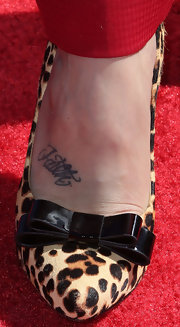 Audra Day added some spice to her look with these leopard print heels with a feminine bow.