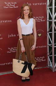 Jayma kept things simple in a white tank and high-waisted silk skirt at the Stuart House Benefit.