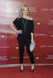 Julie dons ankle length black slacks for this sleek black look at The Stuart House benefit.