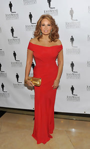 Raquel Welch looked glamorous in a red off-the-shoulder gown at the John Wayne Cancer Institute ball.