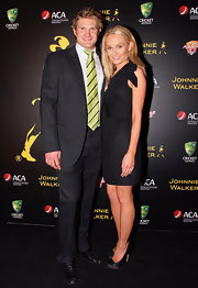 Shane Watson's stylish black suit and yellow tie were a handsome pairing.