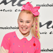 JoJo Siwa finished off her sweet ensemble with a pair of bow earrings.