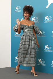 Zazie Beetz looked charming in an off-the-shoulder gray plaid dress by Rosie Assoulin at the Venice Film Festival photocall for 'Joker.'