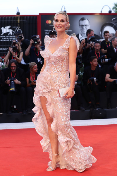 Molly Sims looked dreamy in a beaded pink gown with a high slit and ruffle detailing at the Venice Film Festival screening of 'Joker.'