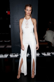 Hailey Clauson went for a summery boho look in a white halterneck jumpsuit when she attended the Jonathan Simkhai fashion show.