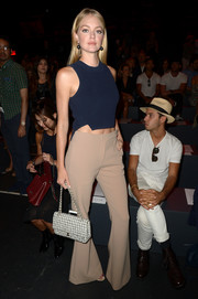 Lindsay Ellingson flashed her toned abs in a navy knit crop-top while attending the Jonathan Simkhai fashion show.