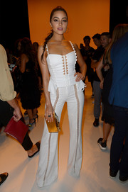 Olivia Culpo was cute and flirty in a white spaghetti-strap peplum top by Jonathan Simkhai while attending the label's fashion show.