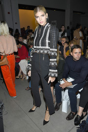 Devon Windsor gave us matador vibes with this Jonathan Simkhai cropped jacket and pants combo during the brand's fashion show.