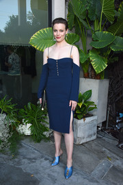 Gillian Jacobs styled her dress with a pair of satin mules in a lighter shade of blue.