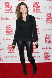 Gina Gershon attended Jony and Marc's (Red) Auction wearing a sweater vest over a button-down.