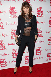 Helena Christensen donned a basic black pantsuit, made sexier with a lace blouse and a leather bandeau, for Jony and Marc's (Red) Auction.