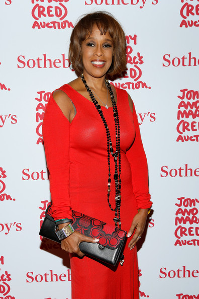 Gayle King attended Jony and Marc's (Red) Auction carrying a stylish black and red leather clutch with an embroidered flap.