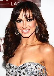 Karina Smirnoff added emphasis to her eyes with deep smoky shades of shadow and ultra-long lashes with lots of mascara at the Joonbug End of the Year Bash