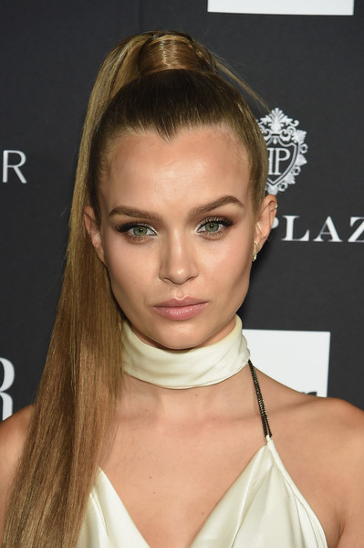 Josephine Skriver Ponytail [hair,face,hairstyle,eyebrow,chin,blond,beauty,lip,forehead,neck,carine roitfeld,estee lauder,stella artois - arrivals,icons,plaza hotel,harpers bazaar celebrates,saks fifth avenue,fujifilm instax,genesis,infor]