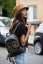 Jourdan Dunn showed off a studded 'Peace and Love' backpack from her collection with Michael Kors while out and about in London.