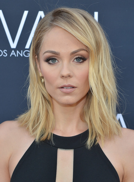 Laura Vandervoort's mussed-up layered hairstyle looked oh-so-sexy during the Jovani LA flagship opening.