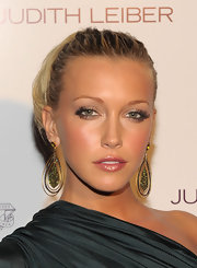 Gold with green stones looks stunning on Katie Cassidy.