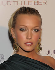 Katie Cassidy added intense lashes to her shimmering look.