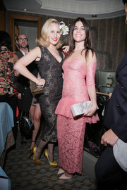 Julia Restoin-Roitfeld hosted a Paris Fashion Week dinner looking sweet in a pink lace peplum gown.