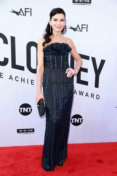 Julianna Margulies Satin Clutch [clothing,red carpet,dress,shoulder,carpet,fashion model,premiere,joint,flooring,hairstyle,dolby theatre,california,hollywood,american film institutes 46th life achievement award gala tribute,george clooney,arrivals,julianna margulies]