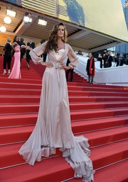 Izabel Goulart made a seductive appearance at the Cannes premiere of 'Julieta' in a floor-sweeping nude Ralph & Russo Couture wrap gown with a corset underlay.