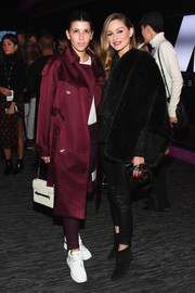 Olivia Palermo cut a sophisticated figure in a black faux-fur jacket at the Jump Into Spring: MICHAEL Michael Kors launch party.