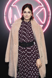 Camilla Belle arrived for the Jump Into Spring: MICHAEL Michael Kors launch party wearing a cozy teddy bear coat.