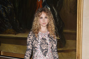Juno Temple Metallic Clutch