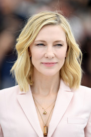Cate Blanchett wore her hair in a casual wavy lob at the 2018 Cannes Film Festival jury photocall.