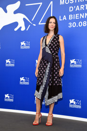 Rebecca Hall added a bright spot with a pair of scarlet ankle-strap heels.