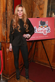 Lindsay Lohan attended the Just Sing It app launch wearing a sophisticated ruched blouse.