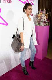 For her bag, Olivia Culpo chose a stylish gray cross-body leather tote.