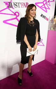 For a spot of brightness to her all-black outfit, Katharine McPhee accessorized with a white envelope clutch.