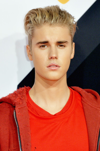 Justin Bieber Fauxhawk [hair,face,hairstyle,eyebrow,blond,chin,forehead,lip,beauty,nose,red carpet arrivals,justin bieber,milan,italy,mediolanum forum,mtv ema]