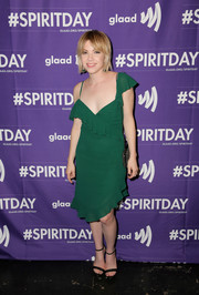 Carly Rae Jepsen looked flirty and sexy in an asymmetrical green ruffle dress at the 'Believer' Spirit Day concert.