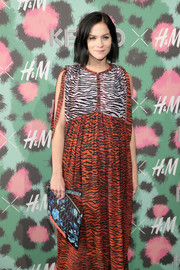 Leigh Lezark mixed a floral clutch with a zebra dress, both by Kenzo x H&M, for the collaboration's launch event.