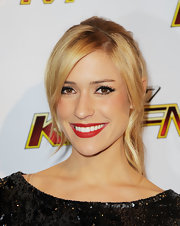 Kristin's layered blonde locks are pulled back in a simple ponytail while her swingbangs are left out to frame her face.