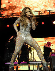 Jennifer Lopez got risque on stage in a one-of-a-kind beaded tulle spider-web bodysuit for her Wango Tango performance.