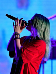 Billie Eilish rocked several gold watches while performing at KROQ Absolut Almost Acoustic Christmas.