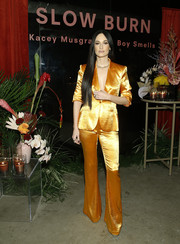 Kacey Musgraves was glowing in a bright orange satin pantsuit by Cinq à Sept at the Slow Burn collaboration launch.