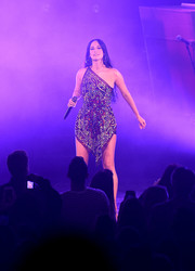 Kacey Musgraves sparkled onstage in an embellished one-shoulder mini dress by Christian Cowan while performing at the Radio City Music Hall.