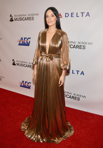 Kacey Musgraves Evening Dress [musicares person of the year,dolly parton,kacey musgraves,red carpet,carpet,clothing,hairstyle,dress,shoulder,premiere,flooring,long hair,gown,los angeles convention center,california,red carpet]