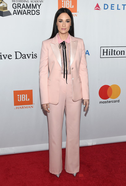 Kacey Musgraves Pantsuit [salute to industry icons,suit,red carpet,clothing,carpet,pantsuit,formal wear,fashion,flooring,tuxedo,premiere,jay-z,kacey musgraves,arrivals,clive davis,grammy,grammy salute to industry icons,recording academy pre-grammy gala,new york city]